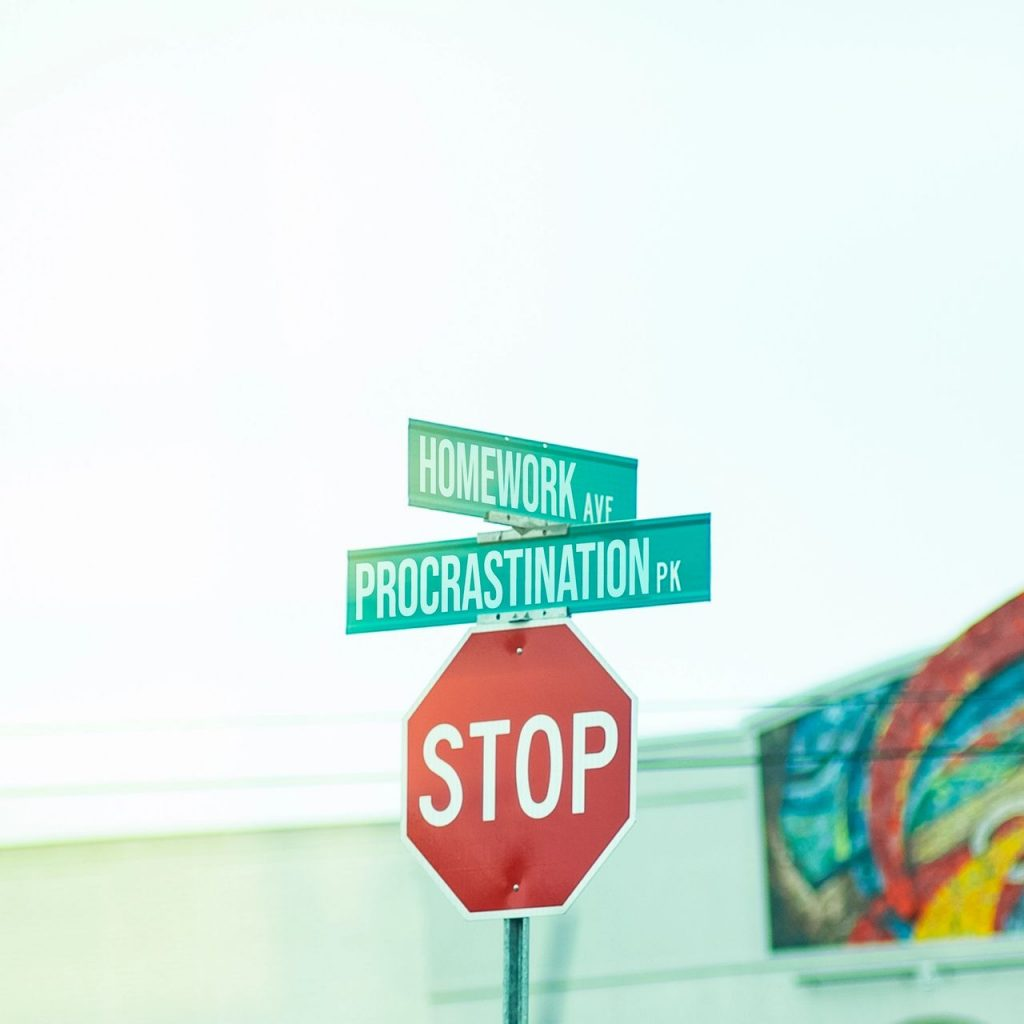 Signs that depict the corner of procrastination and homework