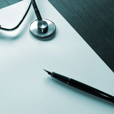 A stethoscope and pen, symbolizing the surroundings of those who deal with chronic illness